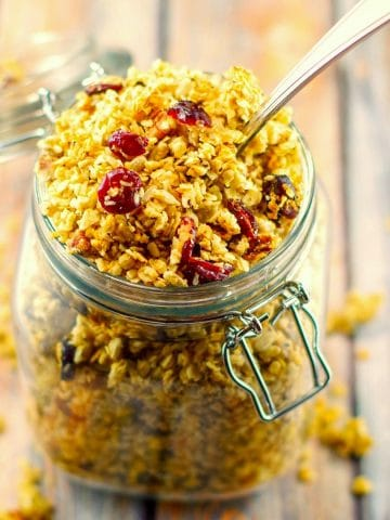 homemade granola in a jar, with a spoon, shot from above