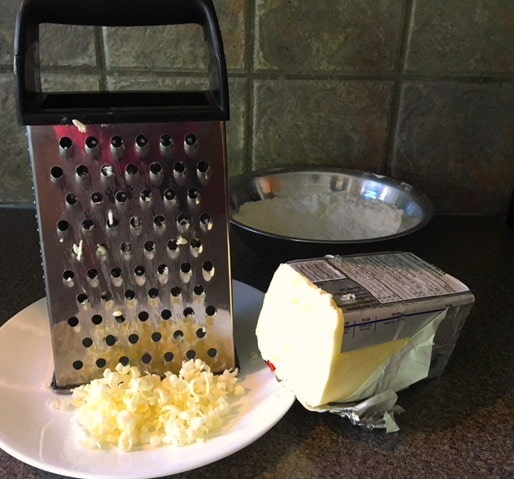 cheese grater being used to 'cut butter into recipe'