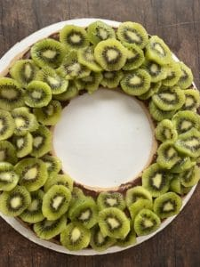 kiwis cut and layered on top of gingerbread cookie with chocolate cream cheese