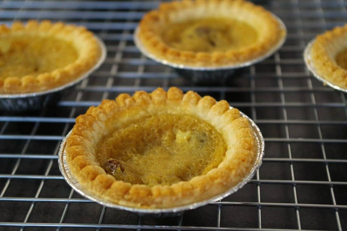 Canadian butter tarts on a wire cooling rack