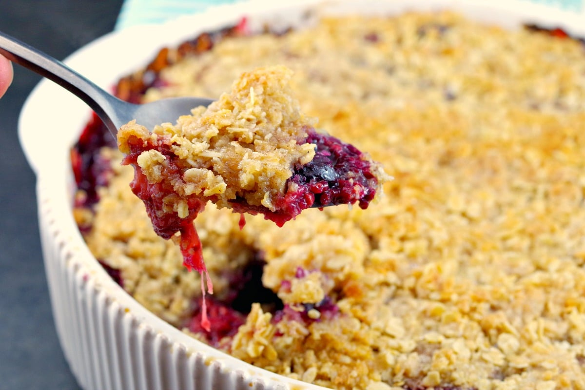 Easy Berry Crumble with frozen mixed berries | and with lemon, mint and coconut - foodmeanderings.com