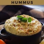 Pinterest pin with black text on gold background with photo of yogurt hummus in black dish