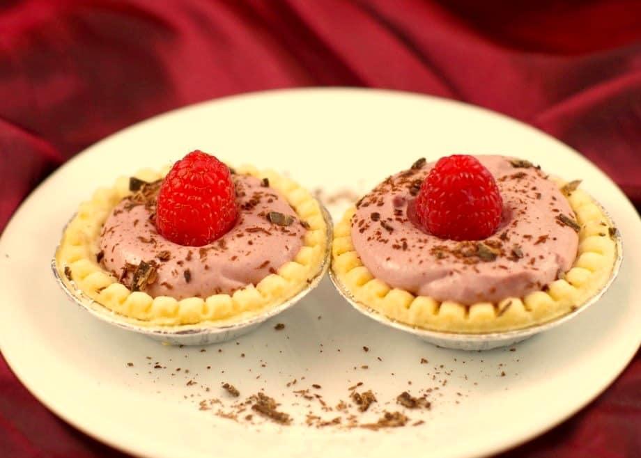 Two Raspberry Tiramisu Tarts on a plate