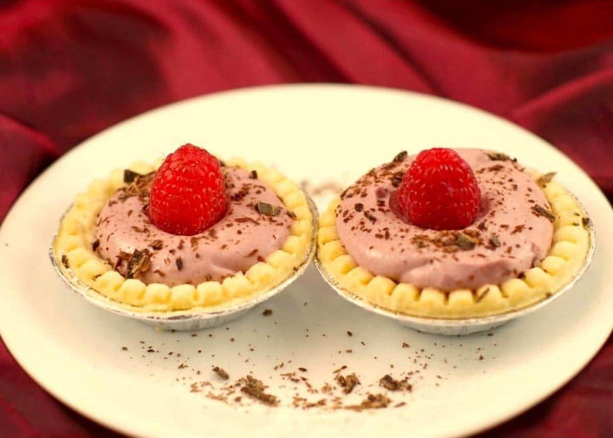 2 raspberry tiramisu tarts on a white plate