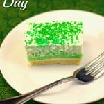 St. Patrick's Day Pistachio Dessert with green sprinkles on top, on a plate with fork
