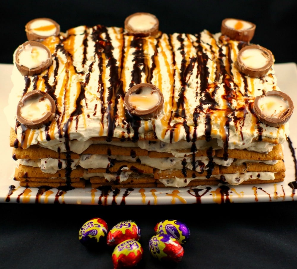 whole easter creme egg cake with some mini Easter creme eggs in front