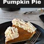 Pinterest Pin with white text on black background on the top and bottom and photo of the best ever pumpkin pie on a black plate in the middle