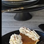 pin with text at top and bottom and photo of piece of pumpkin pie with whipped cream on a black plate with black platter stand in the background, with pie on platter