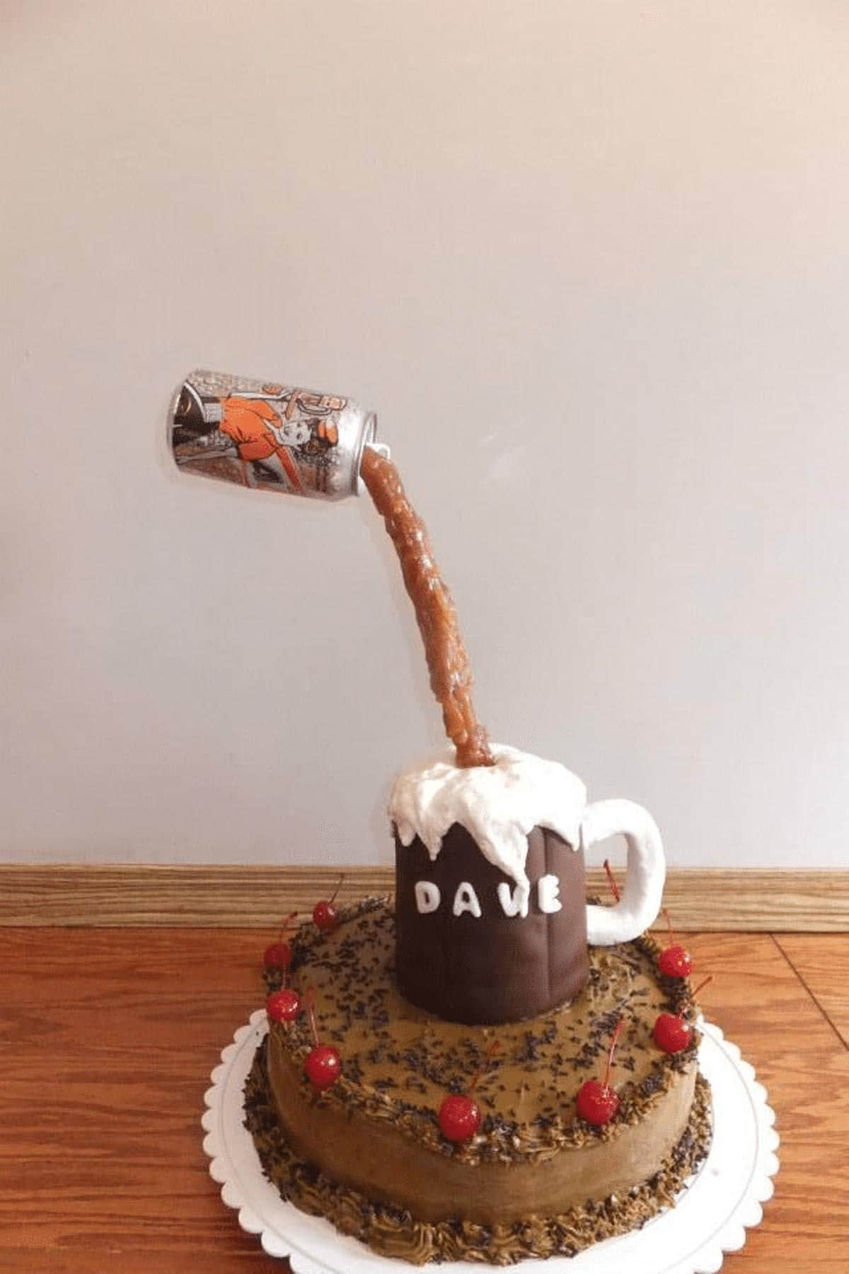 gravity defying root beer cake with can suspended in air over fondant mug, on top of root beer cake