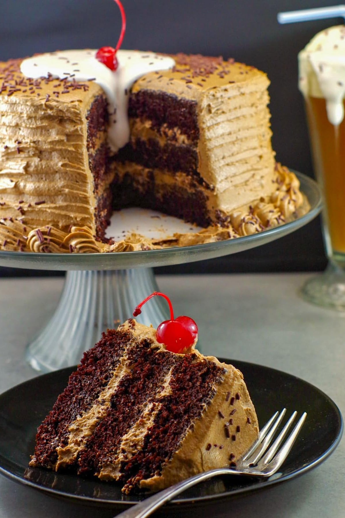 piece of root beer float cake in foreground with remainder of cake in background