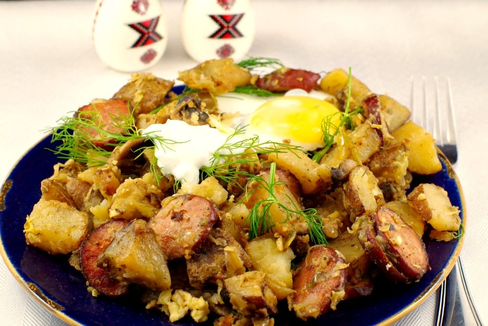 This easy Ukrainian recipe uses home made hash browns that can be made with fresh or leftover baked potatoes, dill, Ukrainian sausage, dry cottage cheese and sauerkraut for an easy and quick breakfast that's the perfect brunch potluck idea.