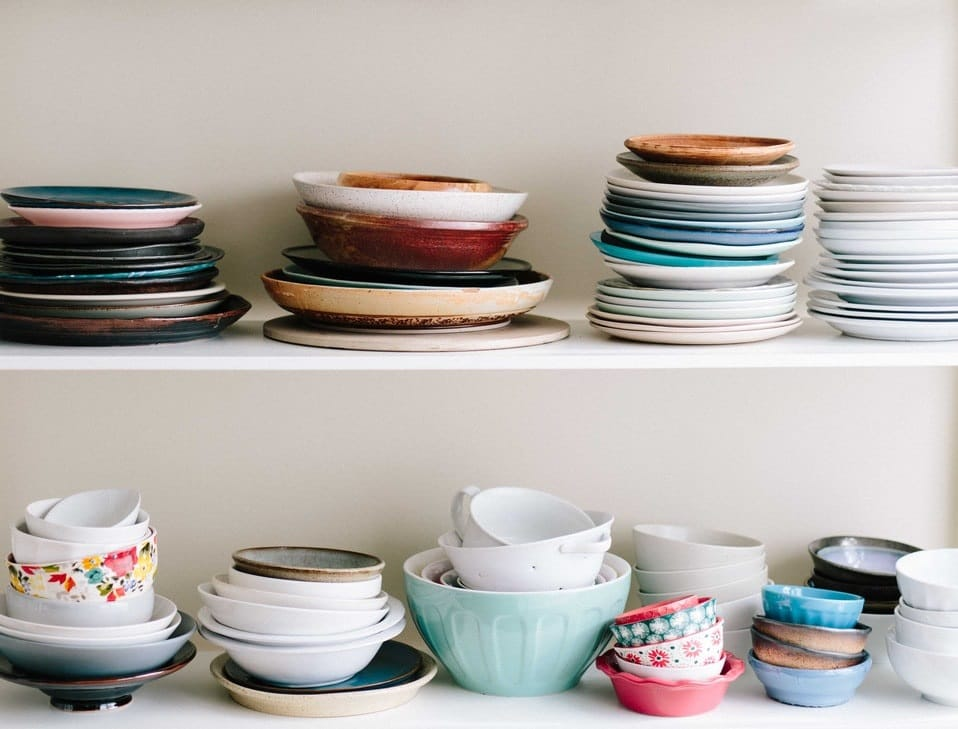 a variety of dishes on 2 shelves