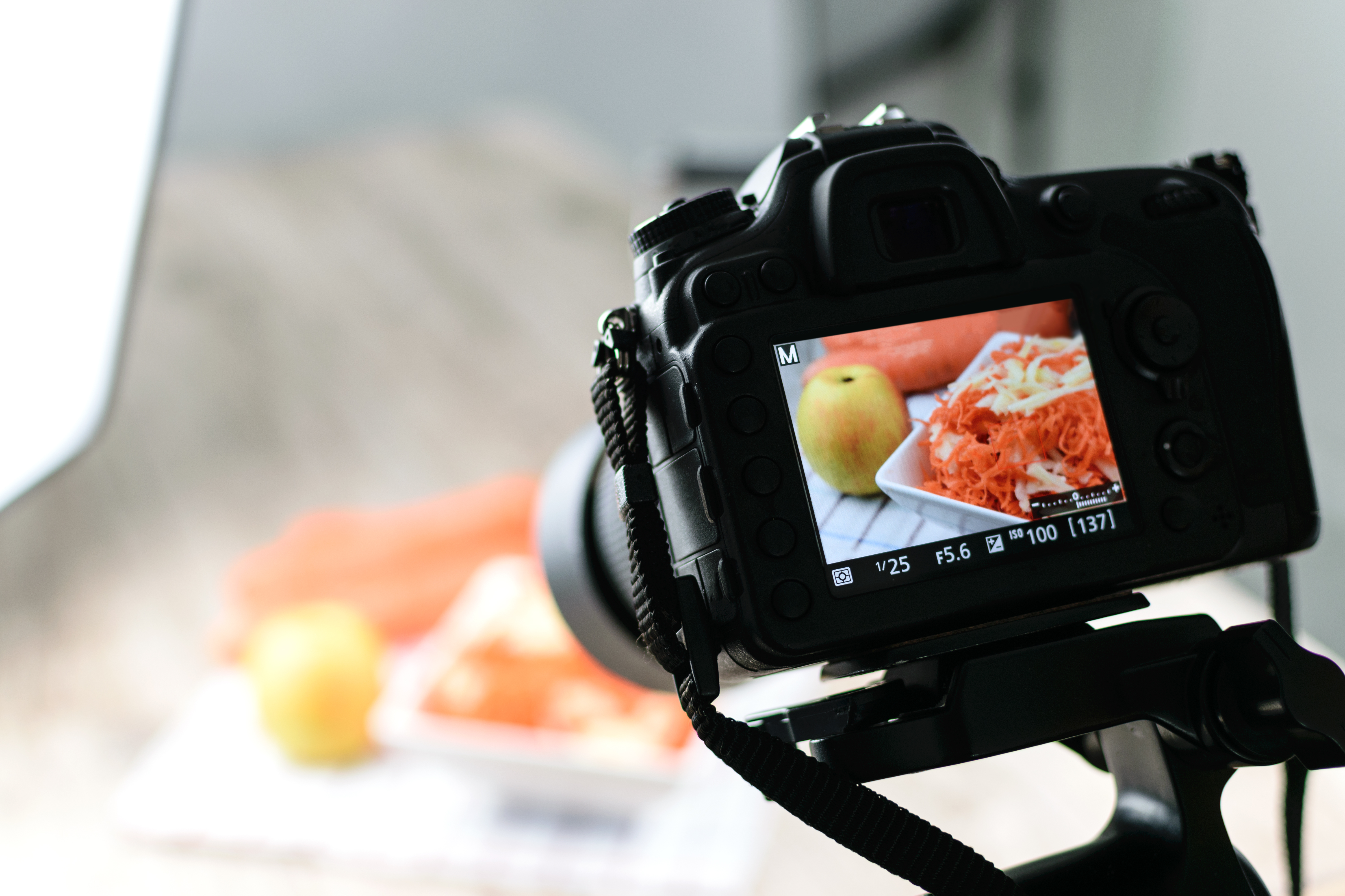 camera set up to take food photos, with image of food in the camera display