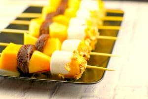 Rocky Road dessert skewers on black tray