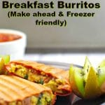 Healthy Mediterranean Breakfast Burritos on a plate with kiwi and salsal