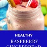 Raspberry gingerbread smoothie in glass jar mug with fresh raspberries and cinnamon stick