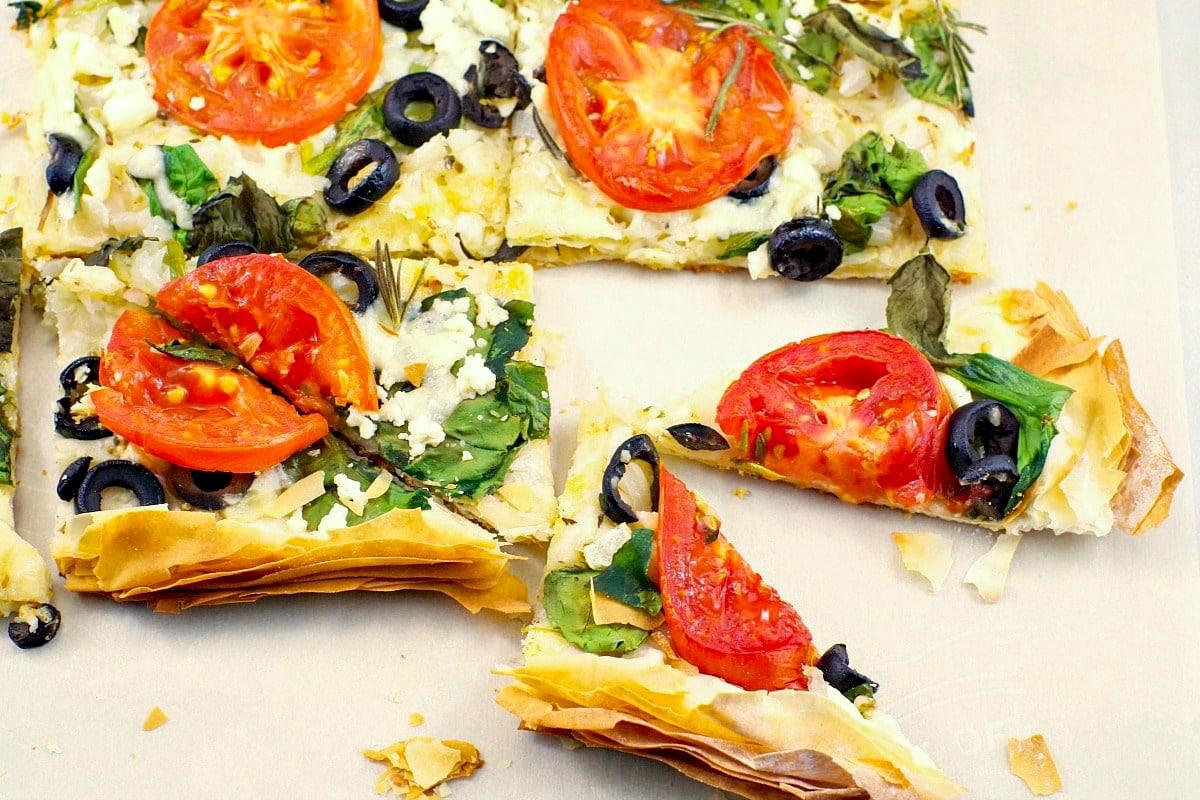 filo pizza cut into triangles