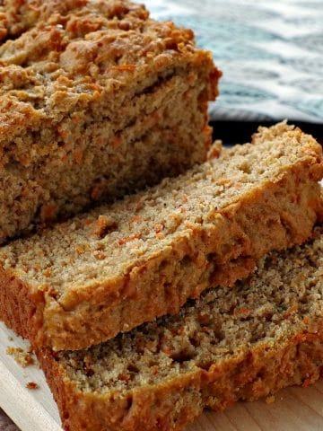 healthy carrot loaf sliced on a cutting board