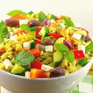 Greek pasta salad in white bowl