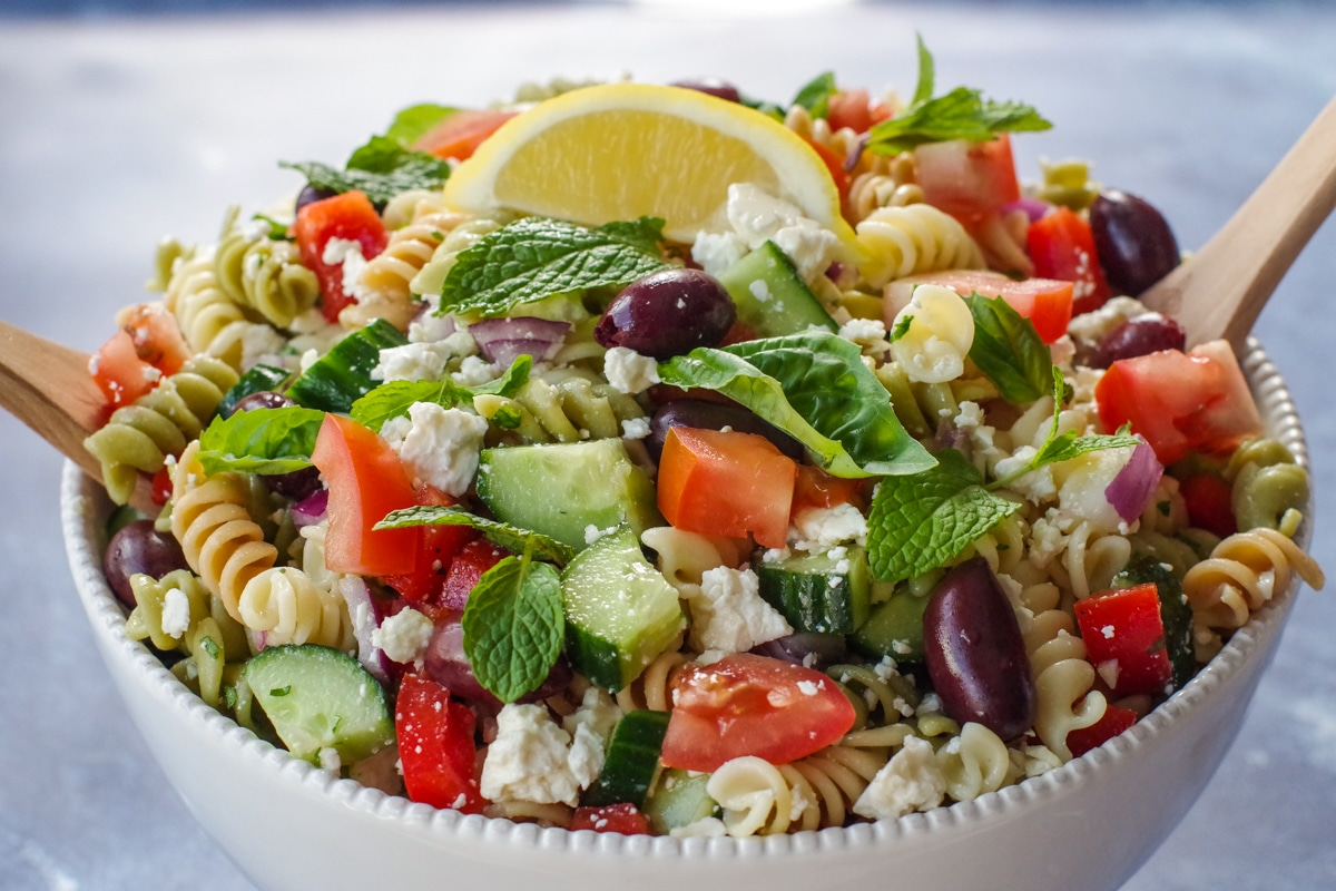 Greek pasta salad in white bowl