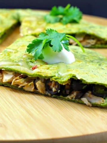weight watchers leftover chicken quesadillas on a wooden cutting board