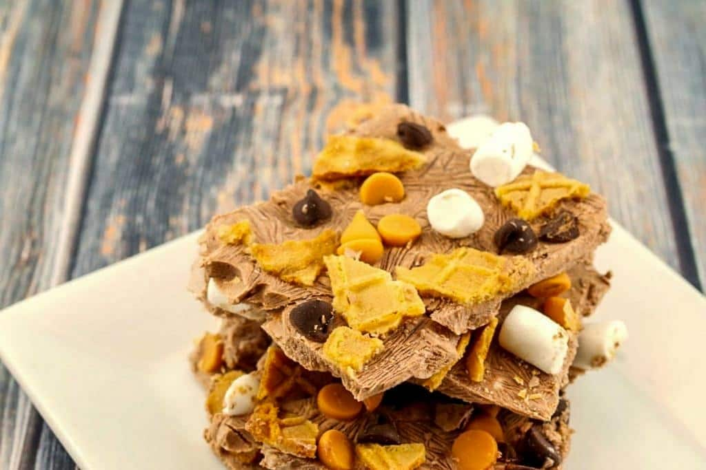 pieces of chocolate frozen yogurt bark stacked on a white plate