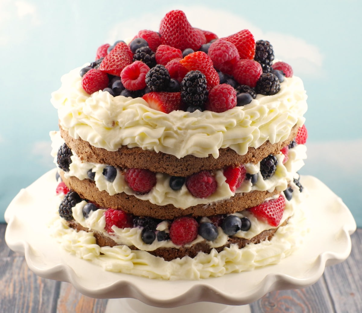 Italian Chocolate Sponge cake with summer berries, whipped cream icing and chocolate mousse
