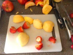 Fruit popsicle making step 1- cut bad parts off food