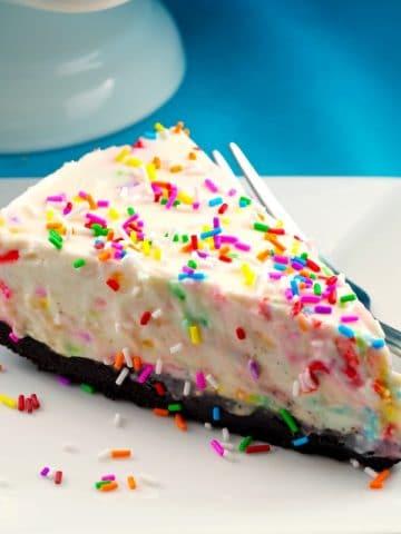 No bake birthday cake cheesecake piece - foodmeanderings.com