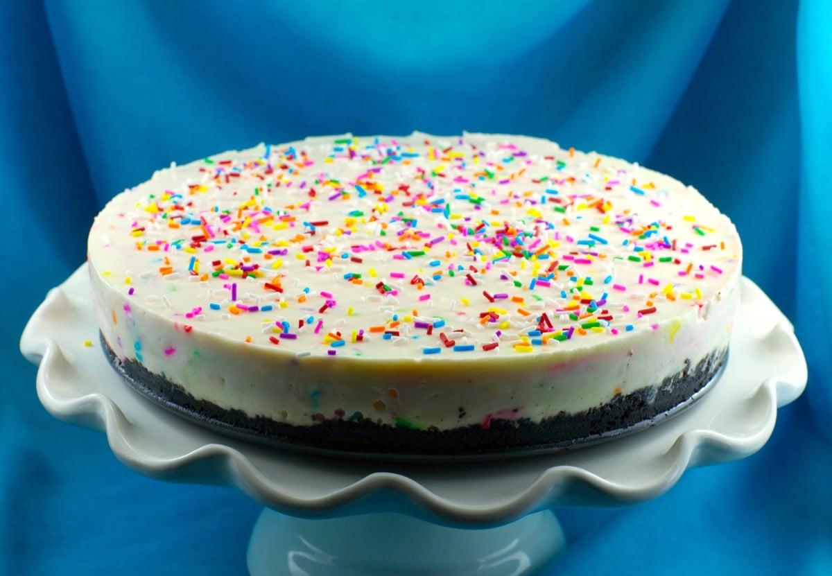 No bake cake batter birthday cake cheesecake -whole cake - foodmeanderings.com