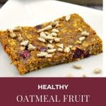 pinterest pin with white text on cranberry background on bottom and photo of healthy oatmeal fruit bar on white plate on top