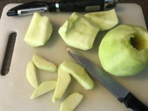 apples on cutting board, peeled and sliced