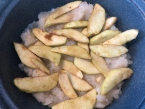 first layers of turnips and apples in blue casserole dish