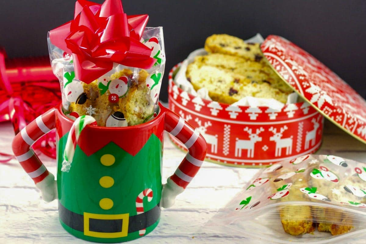 Christmas biscotti in a Christmas mug with a gift box of biscotti in the background