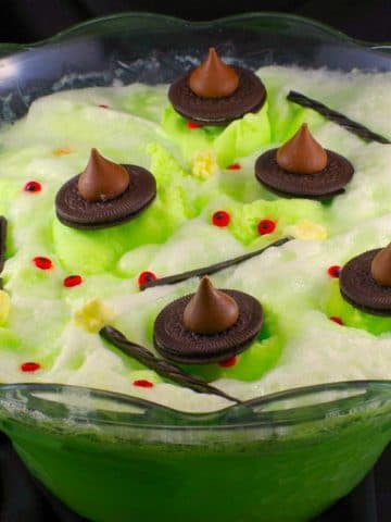 melting witch Halloween punch in punch bowl with black material in the background
