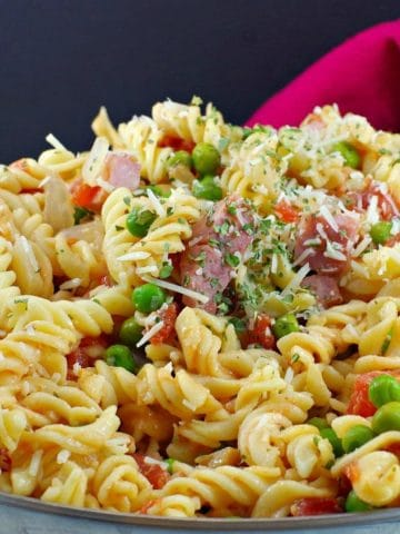ham pasta in a pot with red napkin in the background