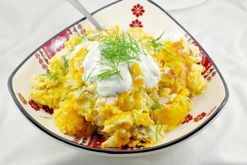 perogie breakfast casserole in Ukrainian printed dish
