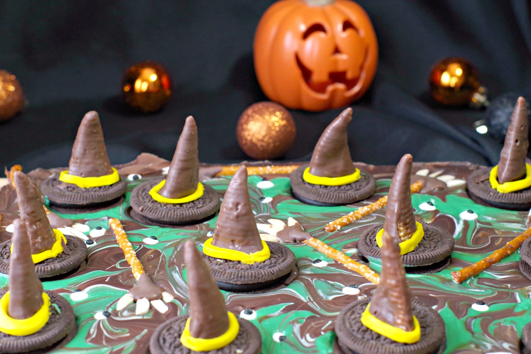 melting witches chocolate Halloween bark with plastic pumpkin in the background