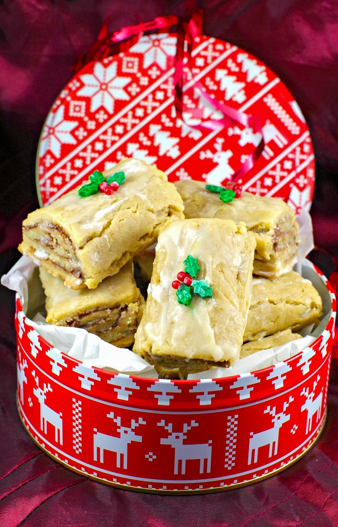 soft Gingerbread Yule log cookies in a red and white Christmas cookie tin