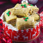 Gingerbread Yule log cookies in a red and white Christmas cookie tin