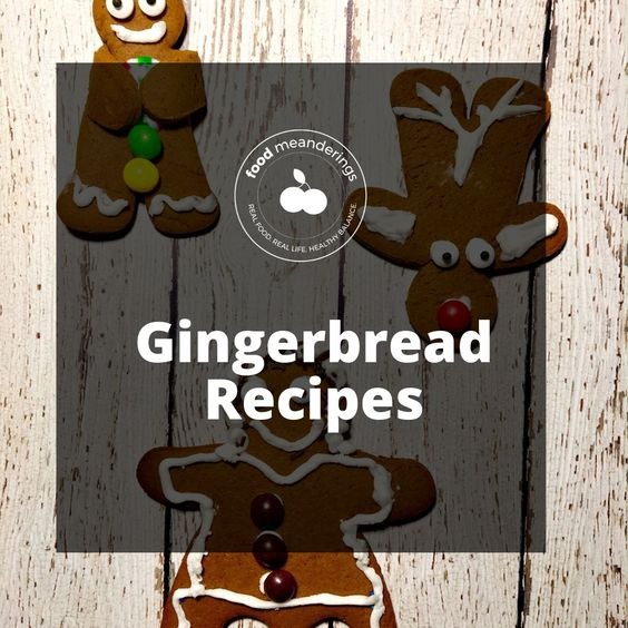 Pinterest gingerbread board cover with white writing on semi-transparent black background and gingerbread cookies in the background