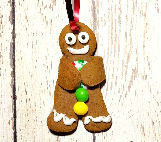 christmas gingerbread man cookie on white wood background
