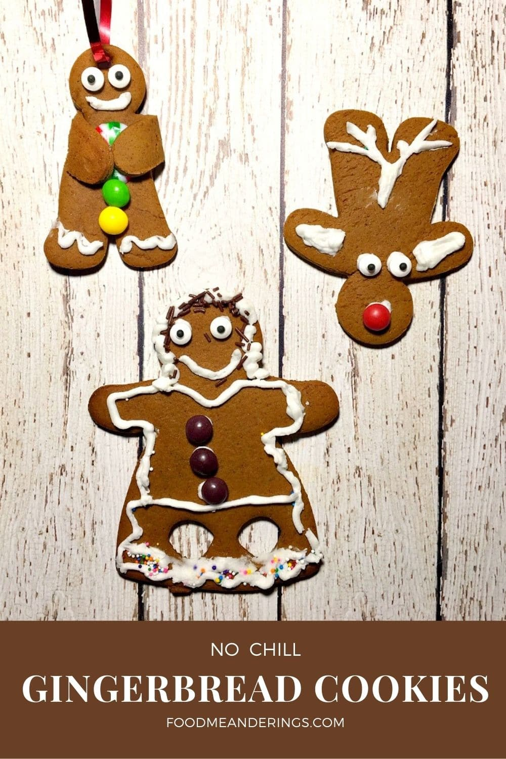 kid decorated gingerbread cookies on white board
