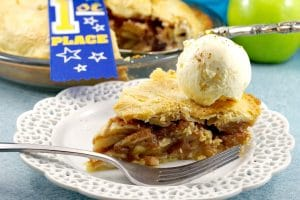 A piece of Deluxe apple pie with ice cream | award-winning apple pie