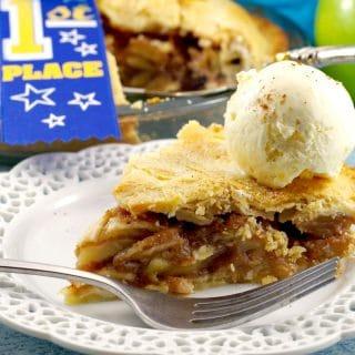 A piece of Deluxe apple pie with ice cream | award-winning apple pie