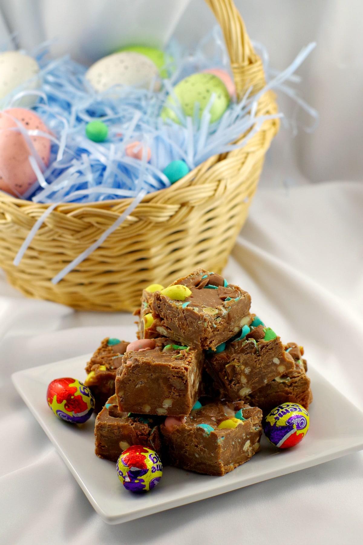 Fudge stacked in front of Easter egg basket