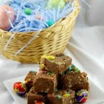 Easter Creme egg fudge stacked in front of Easter Egg basket