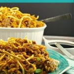 Chow Mein Hotdish casserole on a plate in front with casserole dish in background