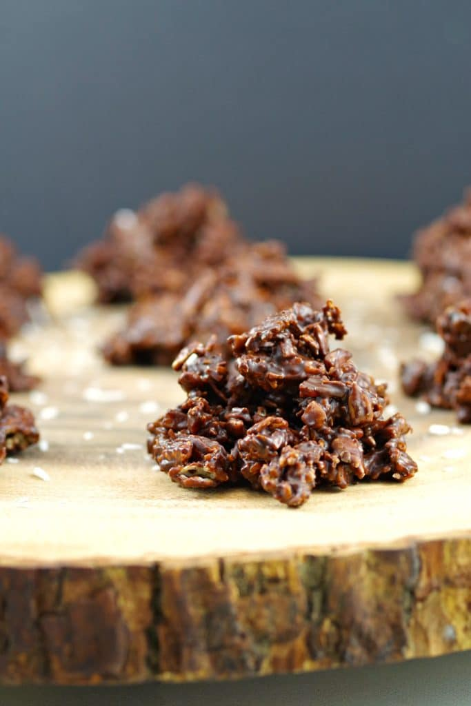 Healthy Chocolate Cluster on a wooden display with more chocolate cluster in background