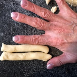 Thickness of dough compared to finger